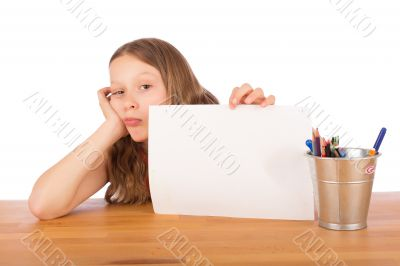 Demoralized child shows a white sheet