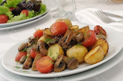 Fried mushrooms with sliced tomatoes and potatoes