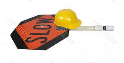Slow Sign on Pole with Construction Hat