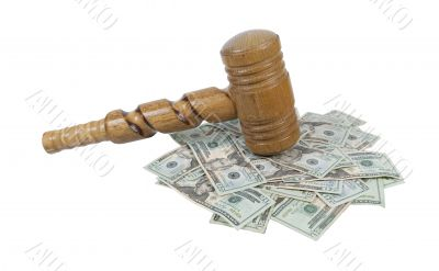 Super Sized Wooden Gavel on a Pile of Money