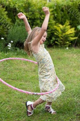 Little girl playing with hula hoop