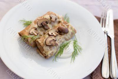 Tasty salty pancakes with mushrooms