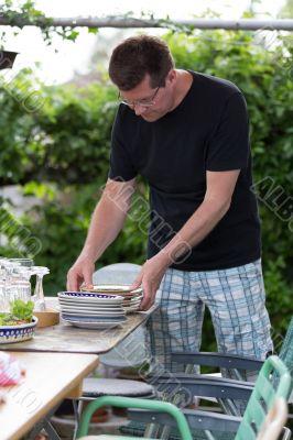 Man preparing plates