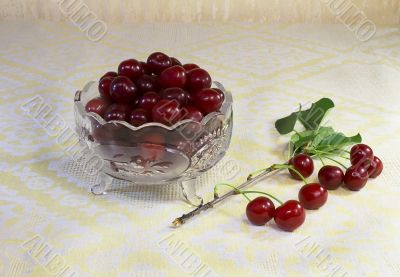 Cherries in a crystal vase on the table