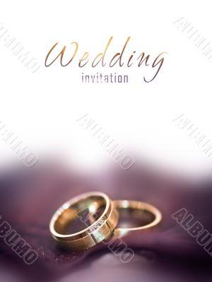 Gold wedding rings on a big brown leaf
