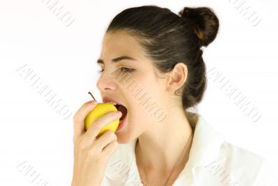 Girl taking a bite of an apple.