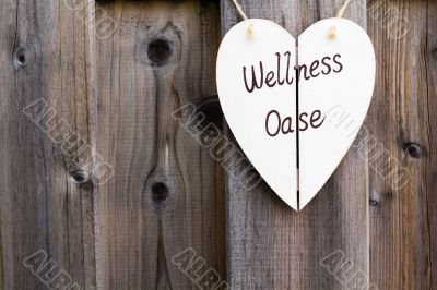 Wooden fence and wellness signboard