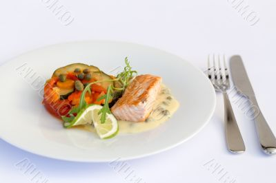 Fish fillet, sauce and vegetables