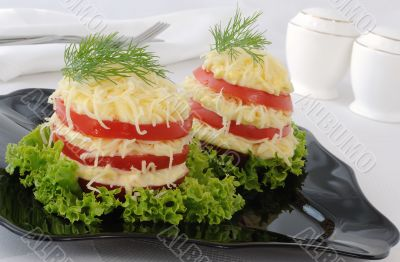Appetizer of tomato slices with a sharp cheese filling