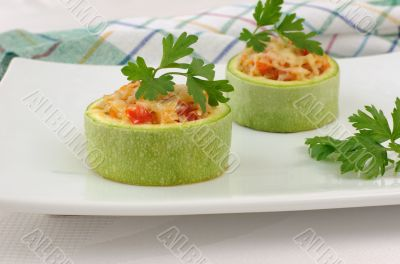 Zucchini stuffed with vegetables and cheese