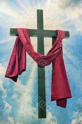 Large christian cross with sun rays