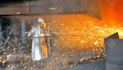 mill worker with hot steel
