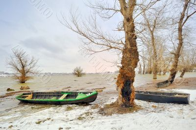 green boat on shore in winter
