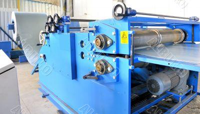 machine for rolling steel sheet in warehouse