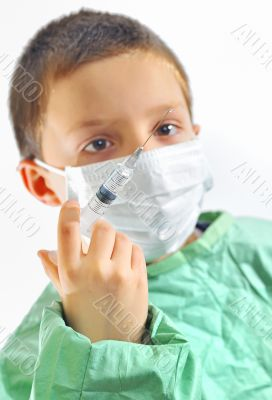 doctor boy with protective mask preparing to inject