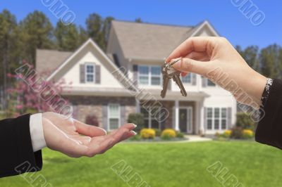 Agent Handing Over the House Keys in Front of New Home