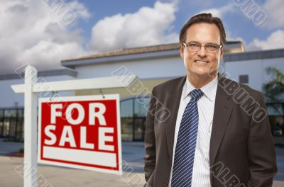 Businessman In Front of Office Building and For Sale Sign