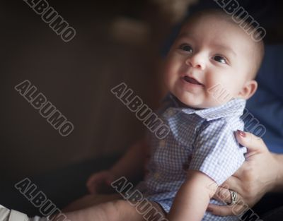 Cute Mixed Race Infant with Parents