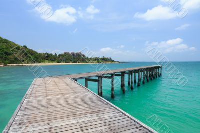 Wooden footbridge over the water near the beach