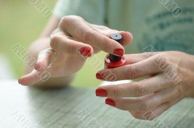Woman Red Nail Polish