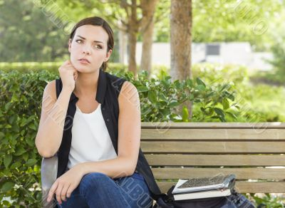 Melancholy Young Adult Woman Sitting on Bench Next to Books