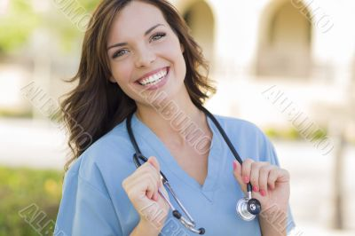 Young Adult Woman Doctor or Nurse Portrait Outside