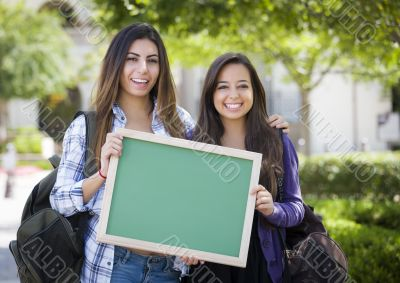 Mixed Race Female Students Holding Blank Chalkboard