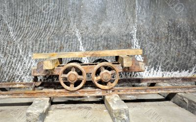 old  wagon inside of salt mine