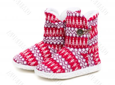 Winter`s warm domestic slippers from a sheepskin