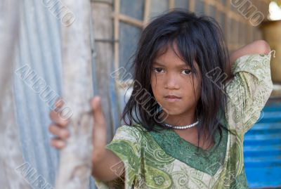 A young girl lives in a fishing village and tourist poses for a