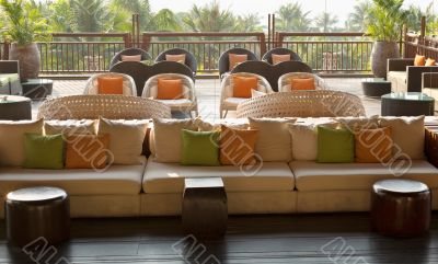 cafe with sofas and cushions, palm