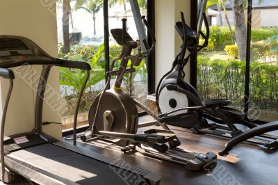 gym with jogging simulators with windows on the tropics