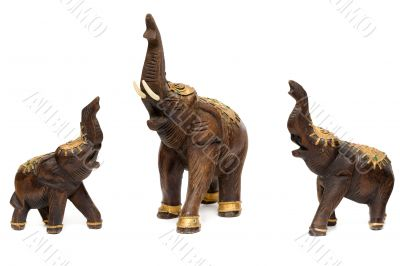 Three wooden statues of elephants