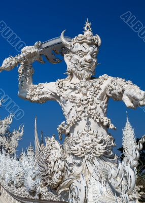 sculpture soldier guards the entrance to the White temple