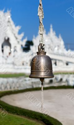 bell on the front of the White Temple Chiang Mai