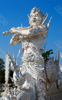 sculpture soldier guards the entrance to the white temple in Chi