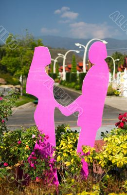 figurines of lovers in a botanical garden