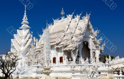 Main chapel of the famous Wat Rong Khun (White temple) in Thaila