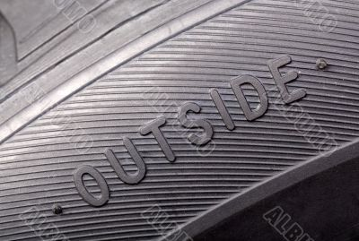 inscription on the wheel close-up `outside`