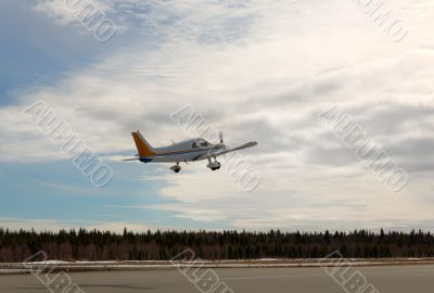 private propeller plane takes off