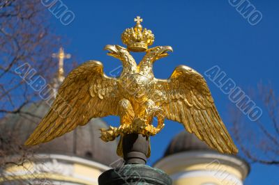 golden double-headed eagle on a background of blue sky