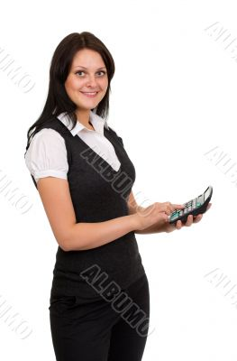 Beautiful smiling girl with a calculator in hand