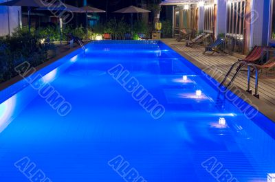 pretty swimming pool in night at a local resort