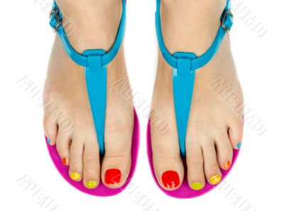 Female feet with a pedicure color