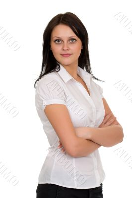 Young beautiful brunette girl in a white blouse