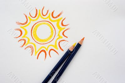Hand drawing sun with pencils