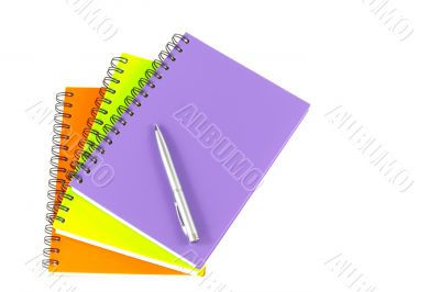 notebook and pen on white background