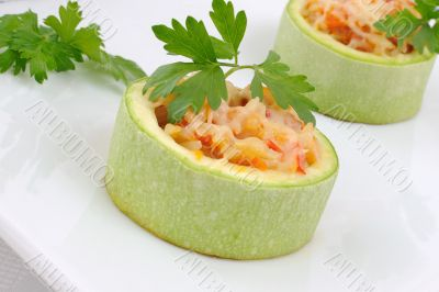 Zucchini stuffed with vegetables with rice and cheese