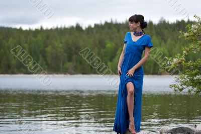 girl in a luxurious evening dress on the lake