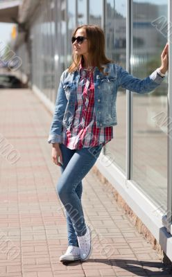 Young beautiful stylish girl in sunglasses on the streets